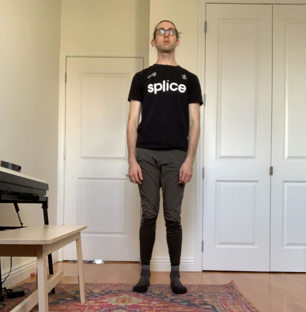 A person standing with posture that is far more relaxed